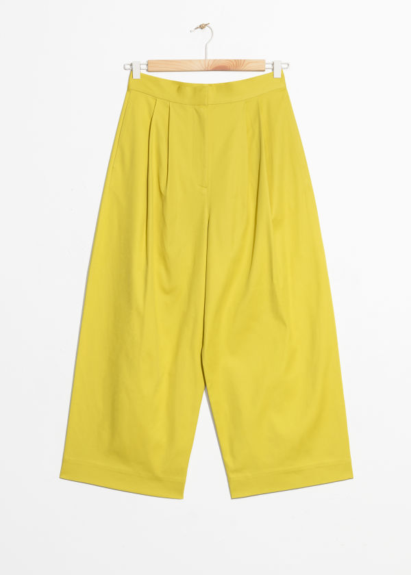 Front image of Stories loose fit trousers in yellow