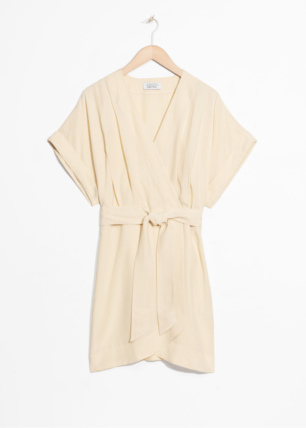 Front image of Stories belted wrap mini dress in beige