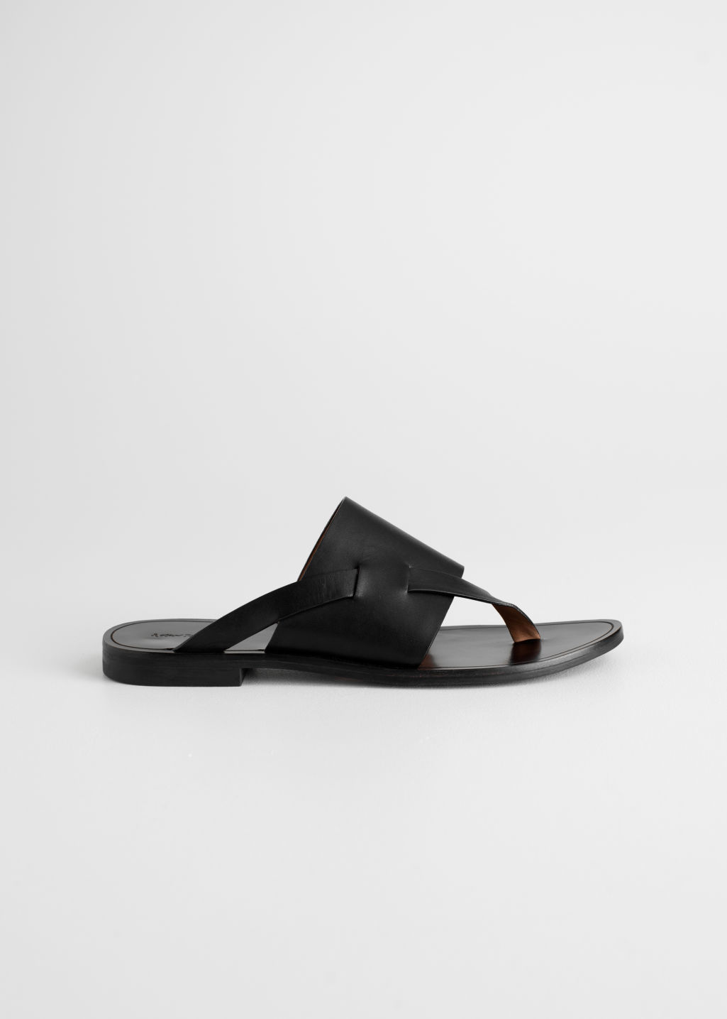 Front image of Stories curved t-bar strap sandals in black