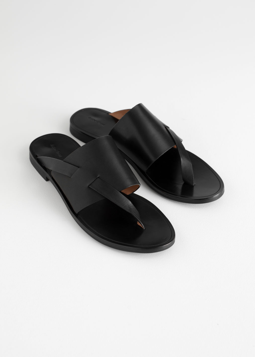 Back image of Stories curved t-bar strap sandals in black
