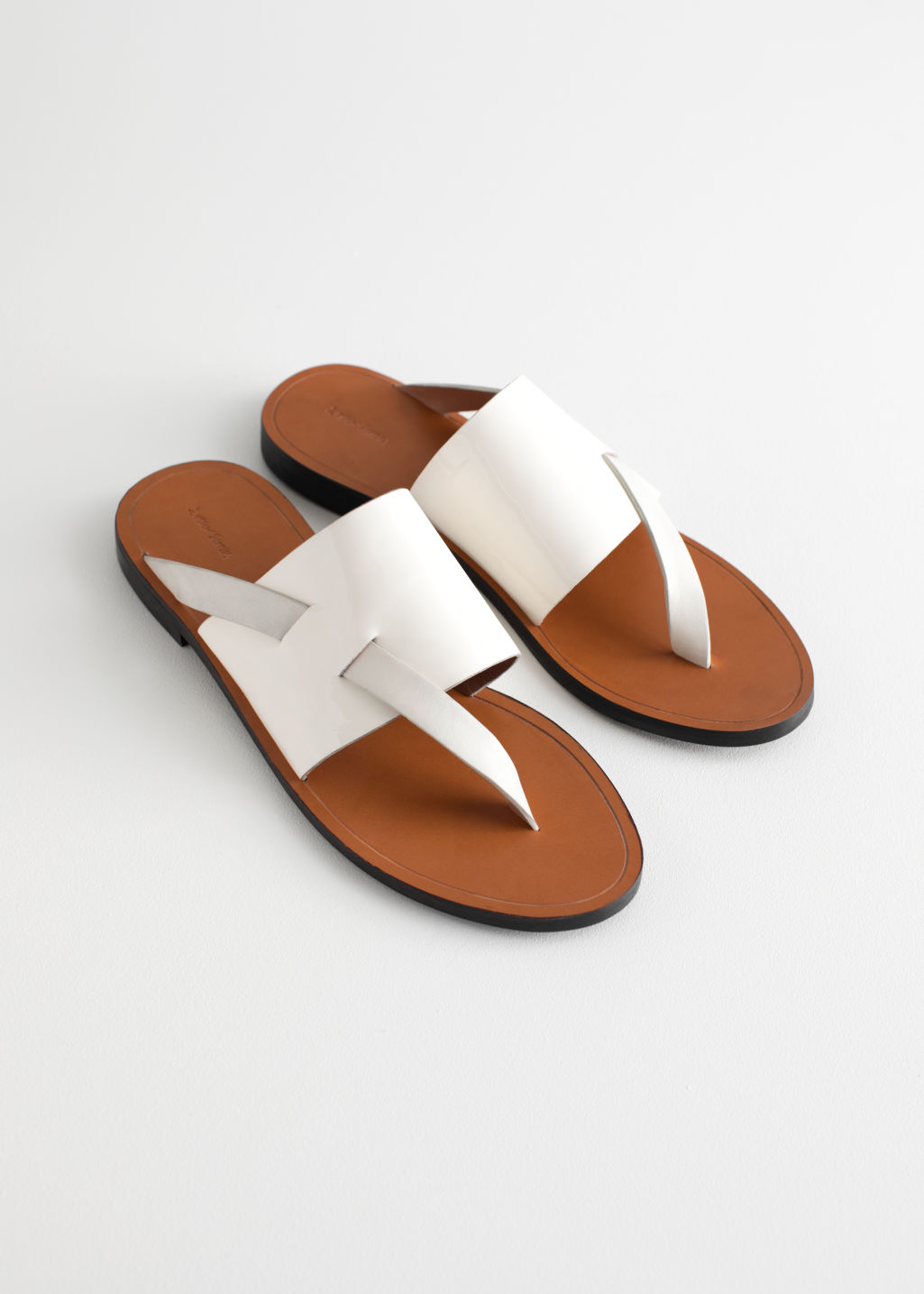 Back image of Stories curved t-bar strap sandals in white