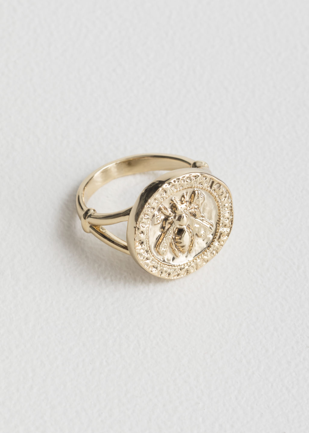 StillLife Front Image of Stories Bee Embossed Pendant Ring in Gold