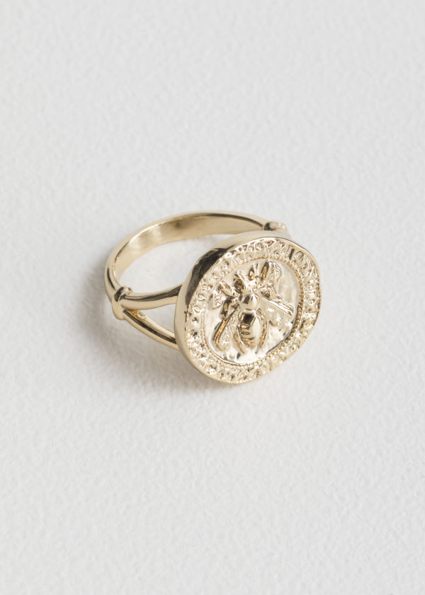 Front image of Stories bee embossed pendant ring in gold