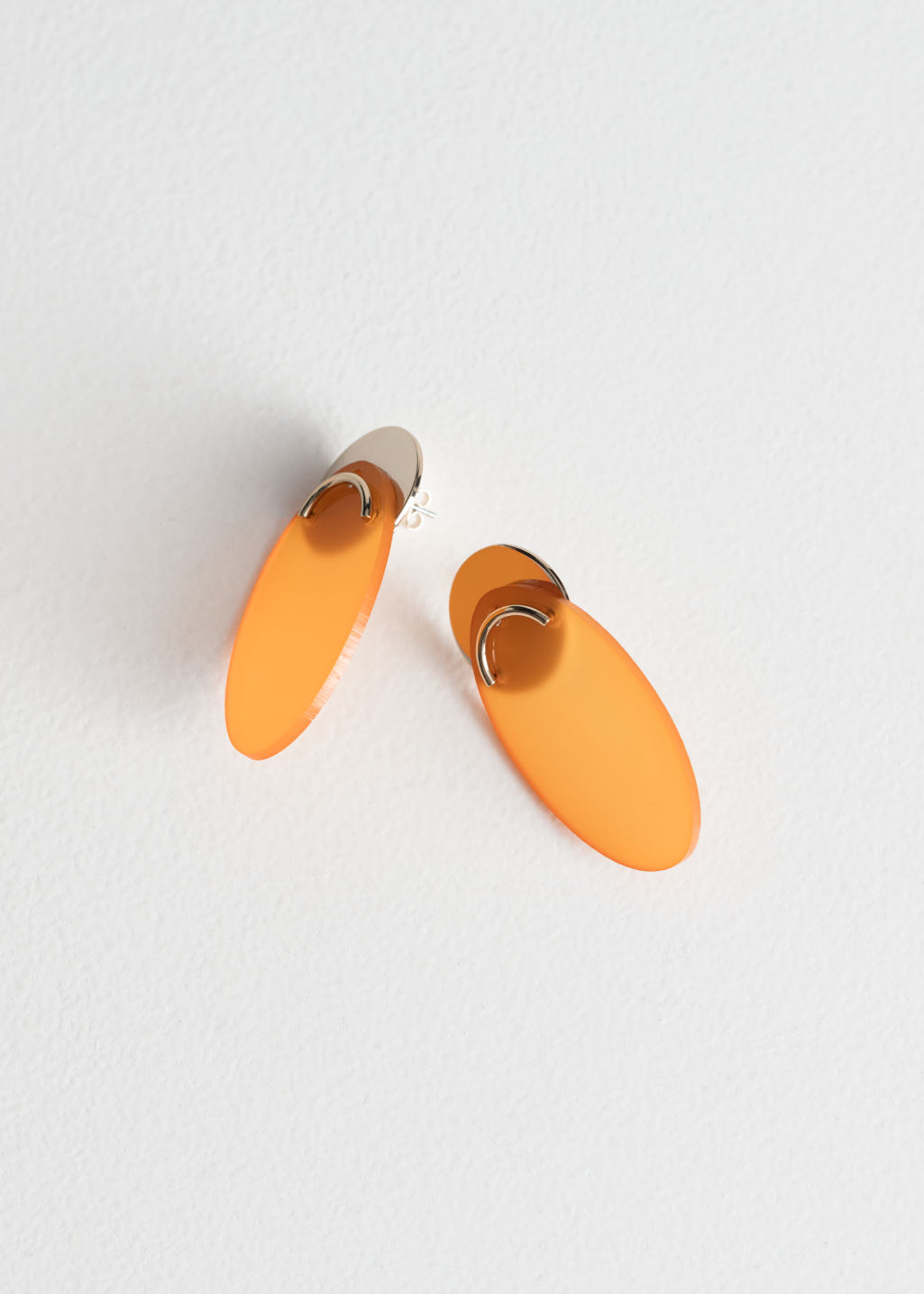 Front image of Stories duo shape earrings in orange