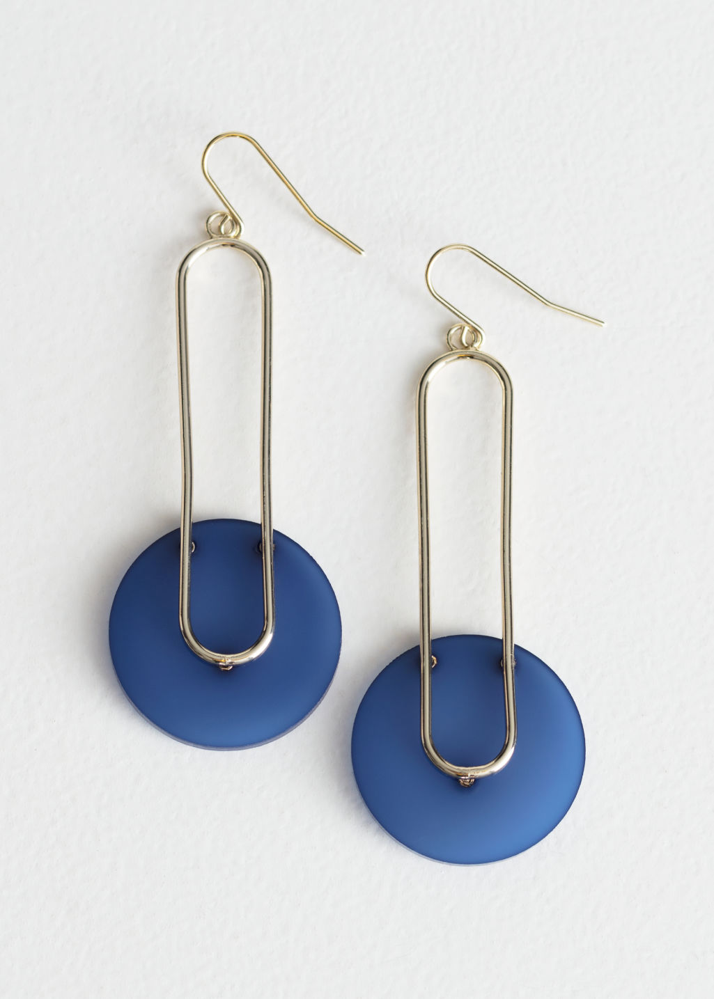 Front image of Stories hanging duo shape earrings in blue