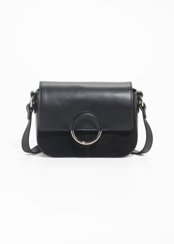 Front image of Stories exposed ring leather bag in black