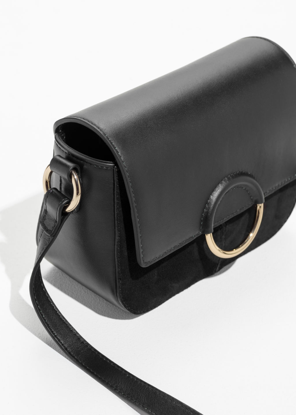 Back image of Stories exposed ring leather bag in black