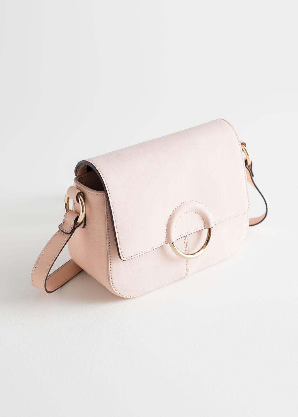 Front image of Stories exposed ring leather bag in beige