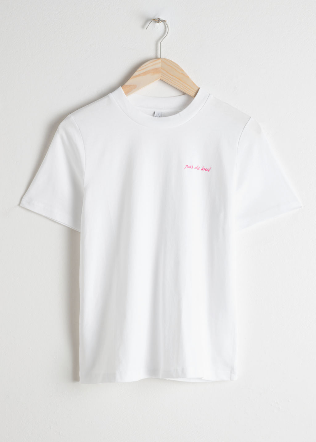 Front image of Stories embroidered pas du tout tee in white