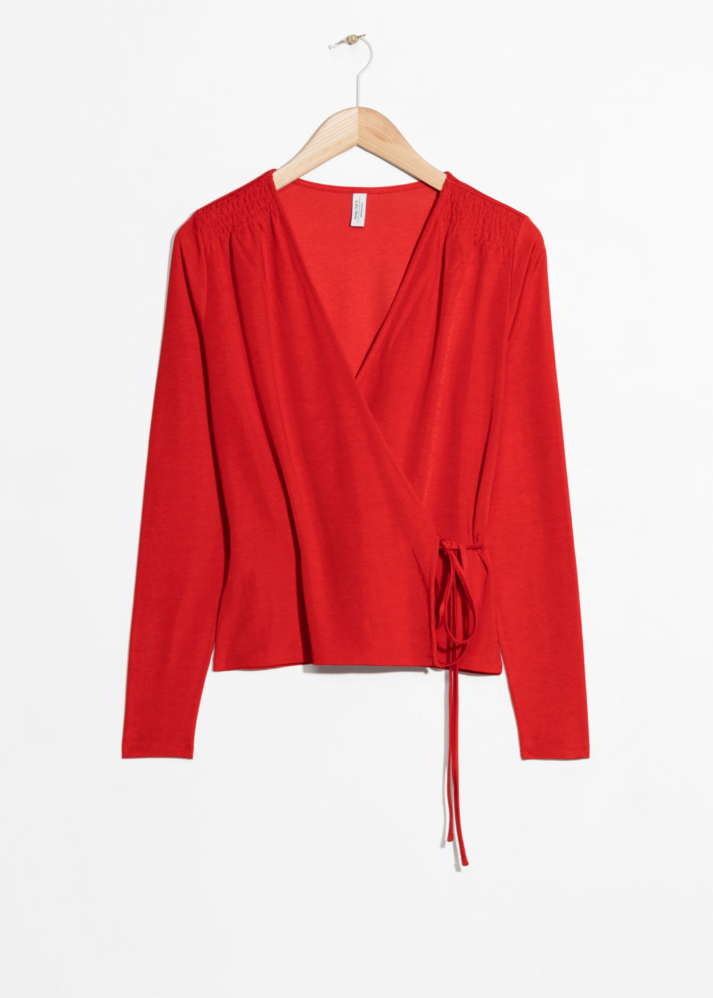 Front image of Stories wrap tie blouse  in red