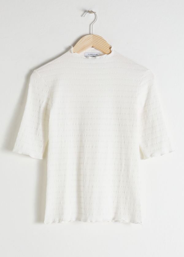 Front image of Stories ruffle mock neck top in white