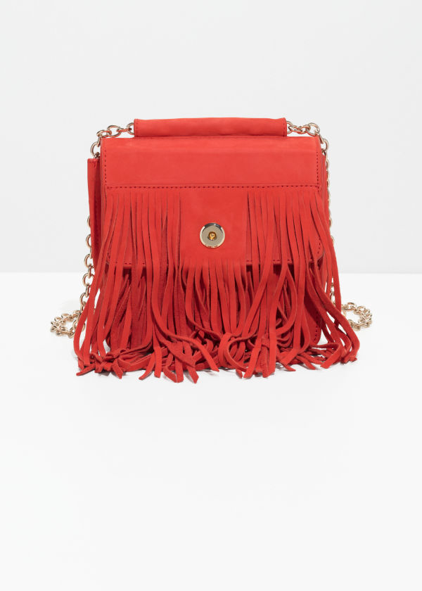 Front image of Stories suede fringe crossbody bag in red