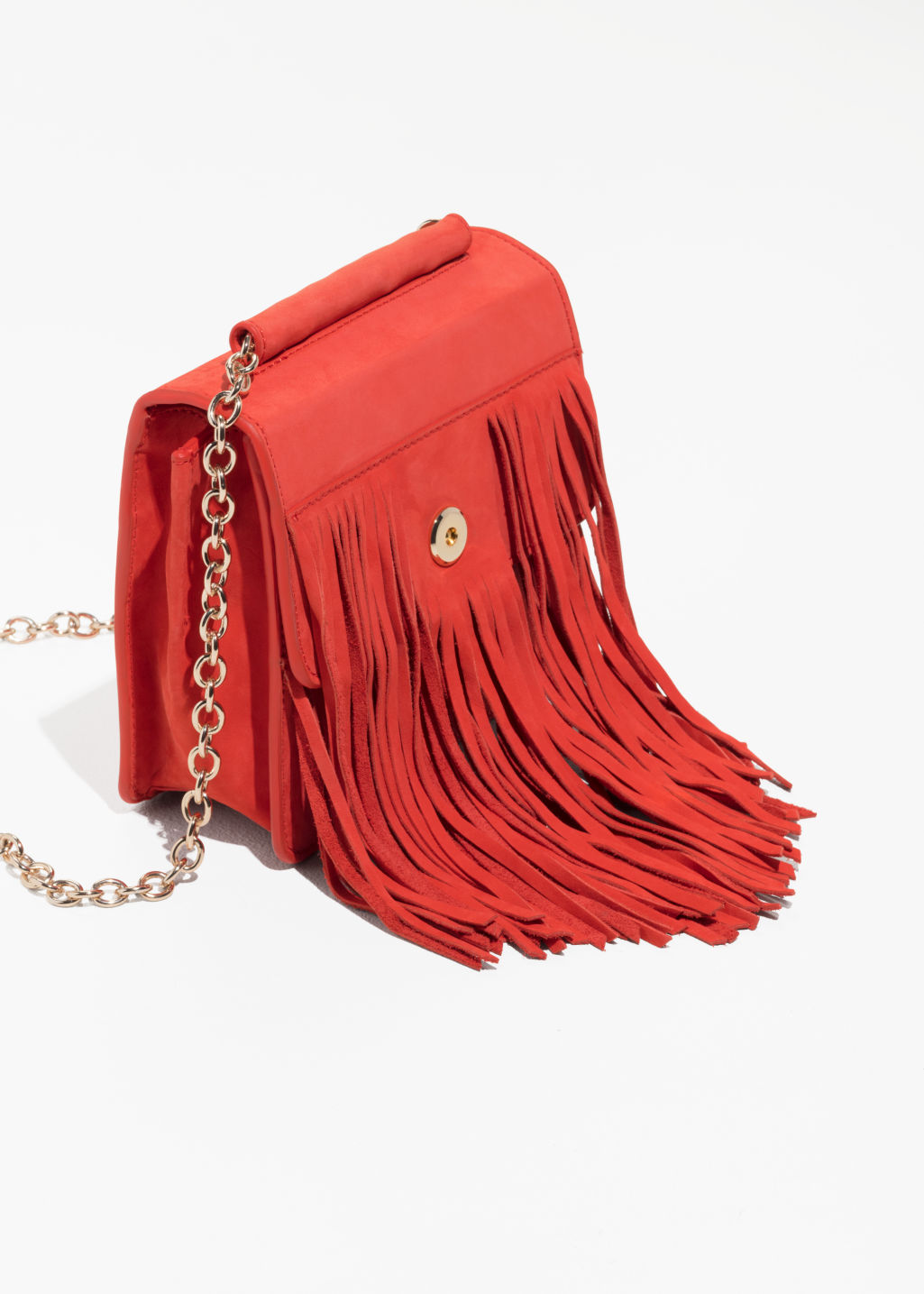 Back image of Stories suede fringe crossbody bag in red