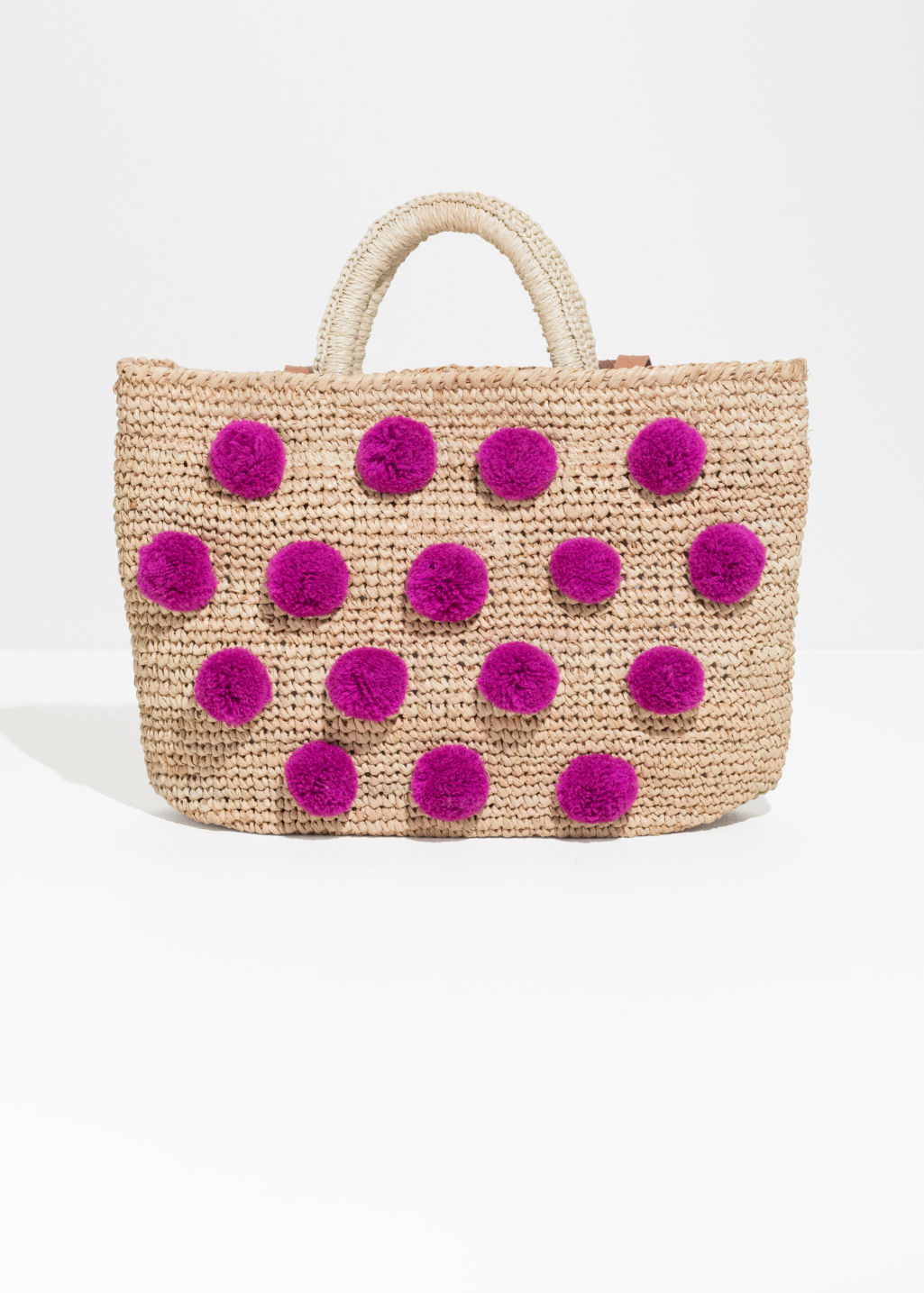 Front image of Stories pom pom woven tote in beige