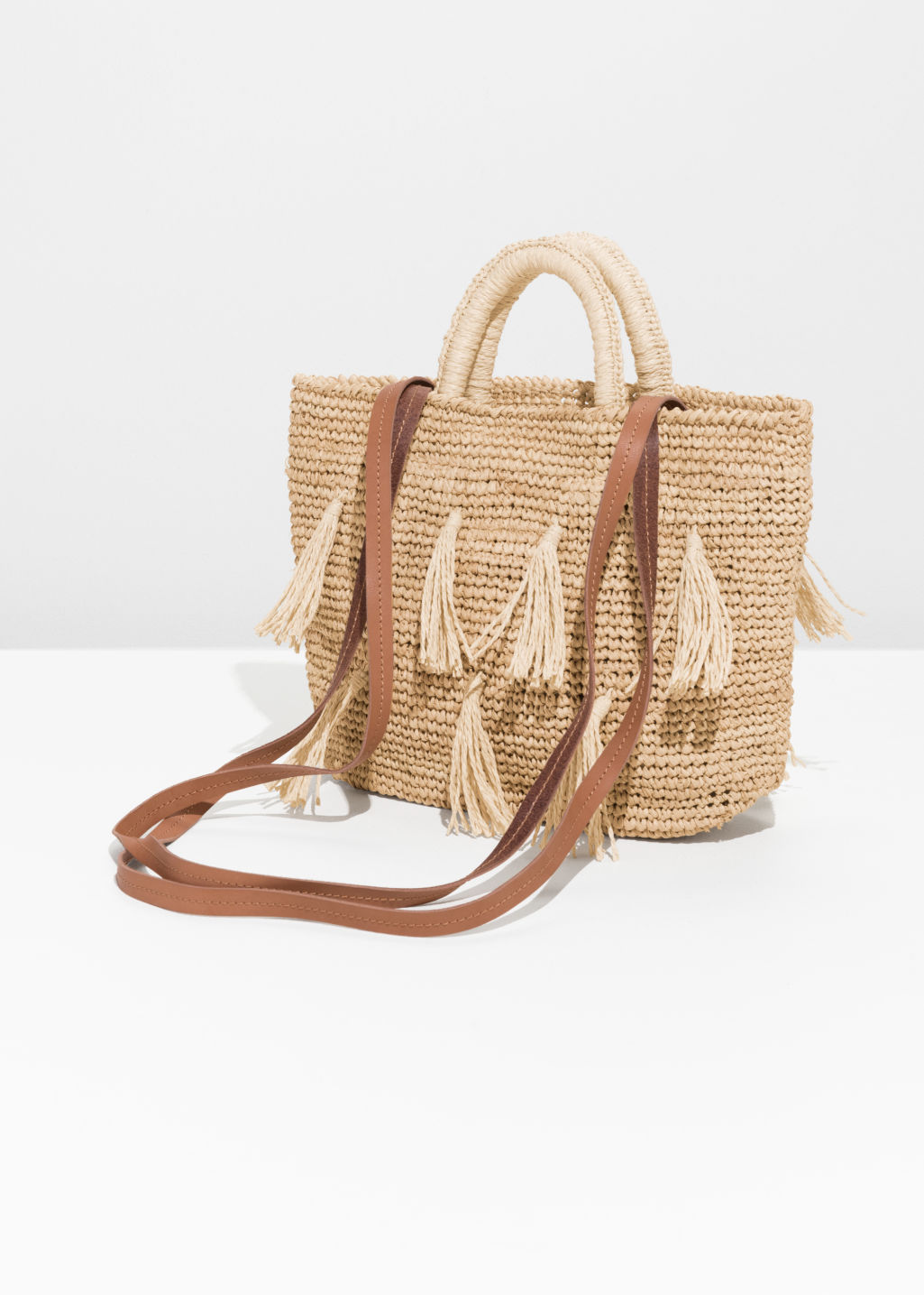 Back image of Stories pom pom woven tote in beige