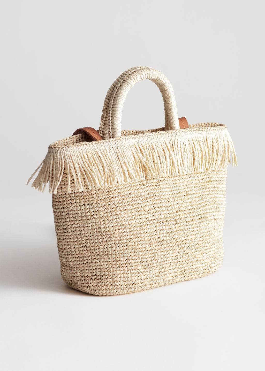 Front image of Stories embellished woven tote in beige