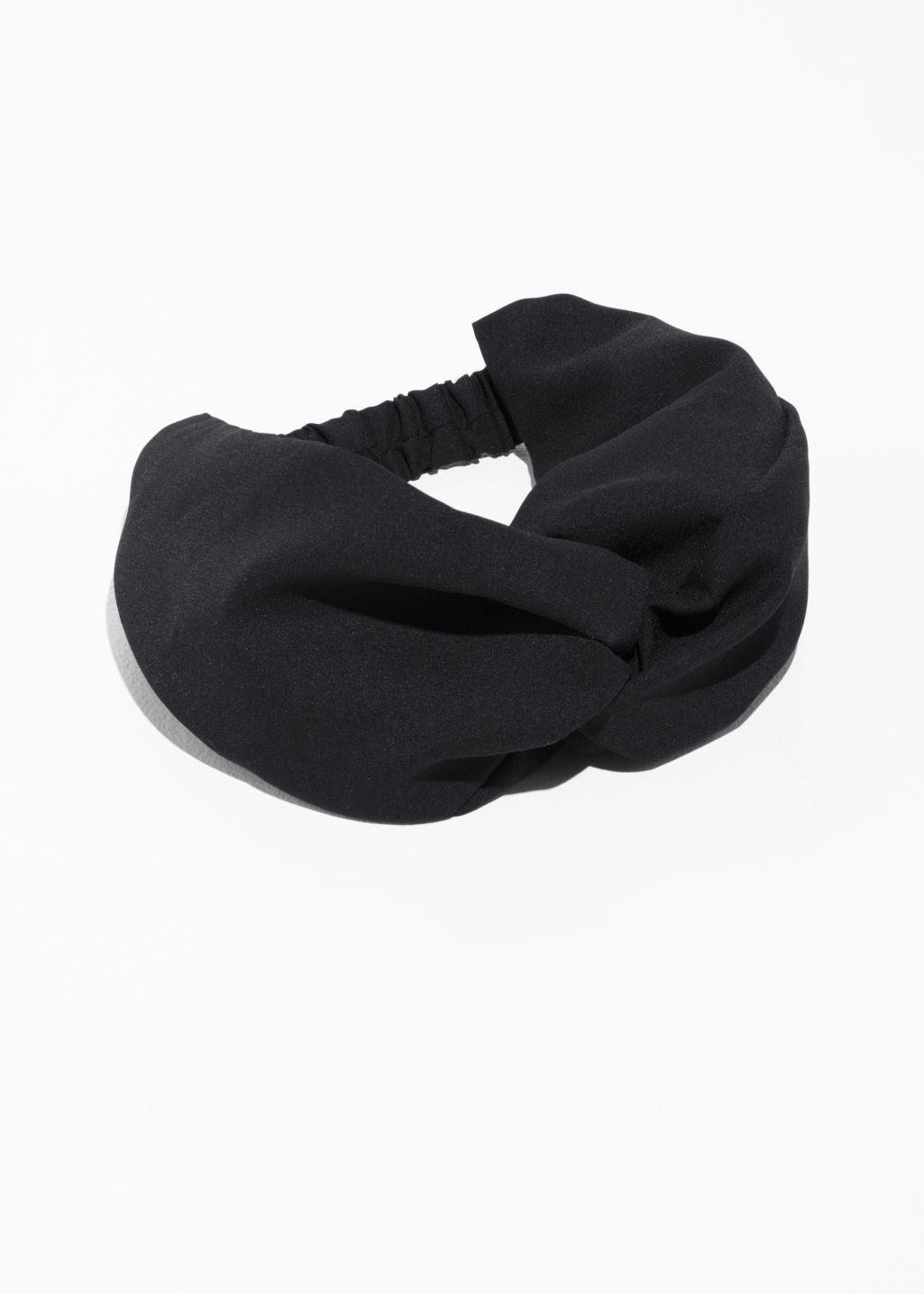 Front image of Stories twist tie headband  in black