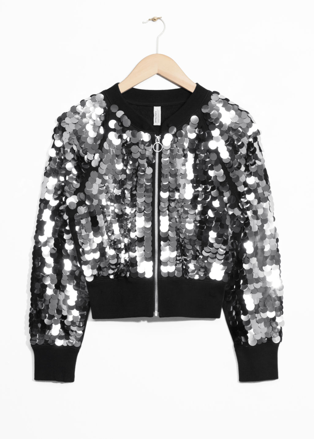 Front image of Stories sequin jacket in black