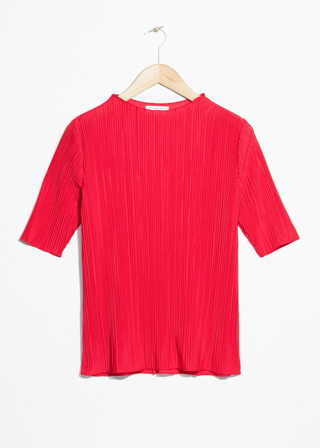 Front image of Stories pleated plisse blouse  in red