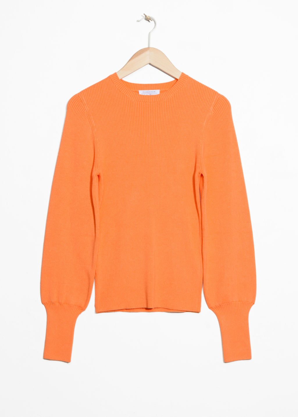 Front image of Stories crewneck sweater in orange