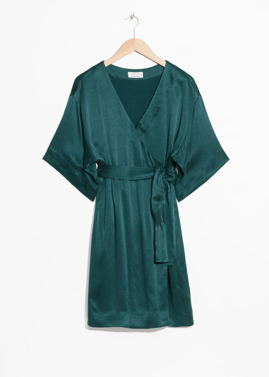 Front image of Stories wrap dress in turquoise