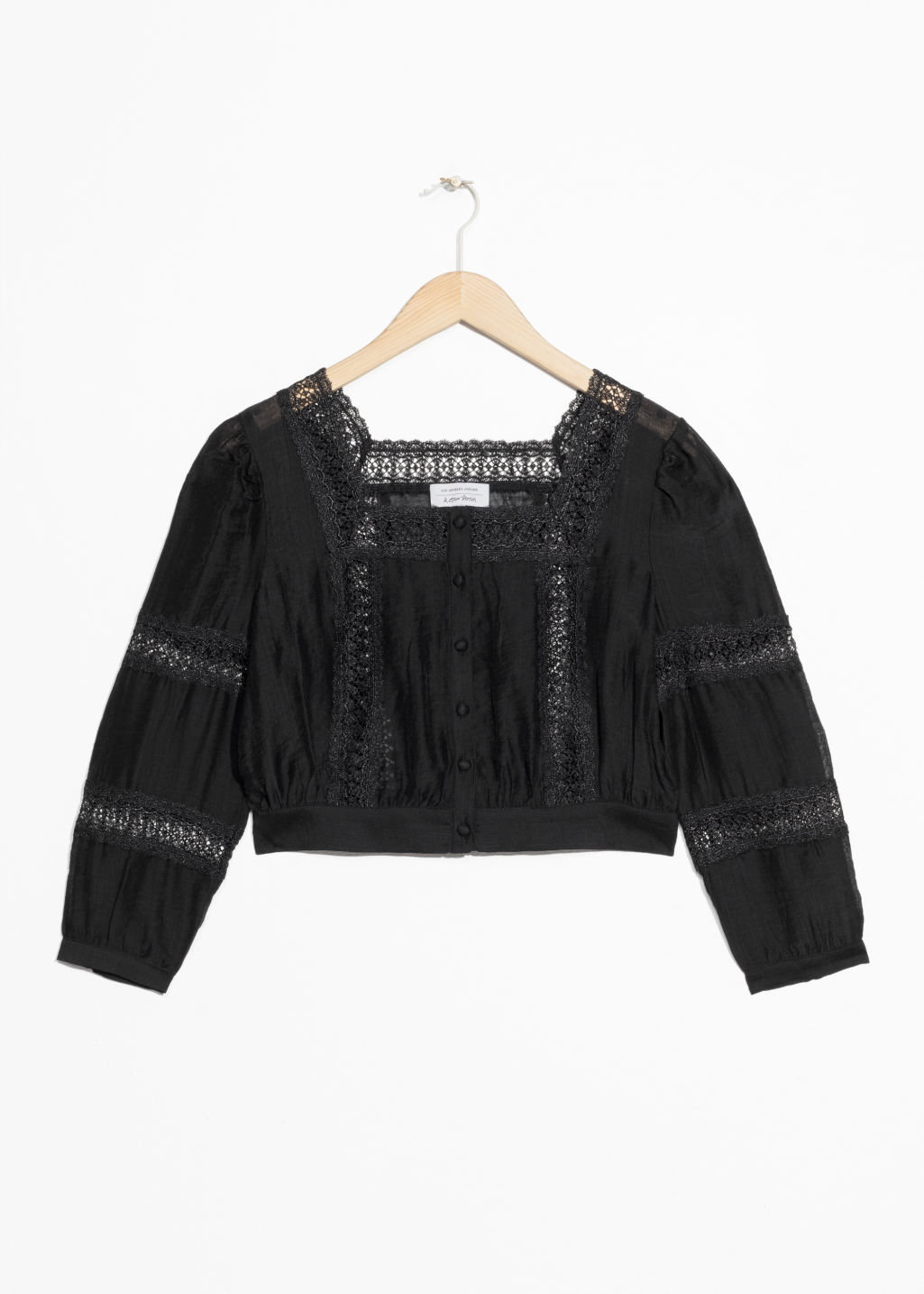Front image of Stories eyelet trim cropped blouse in black