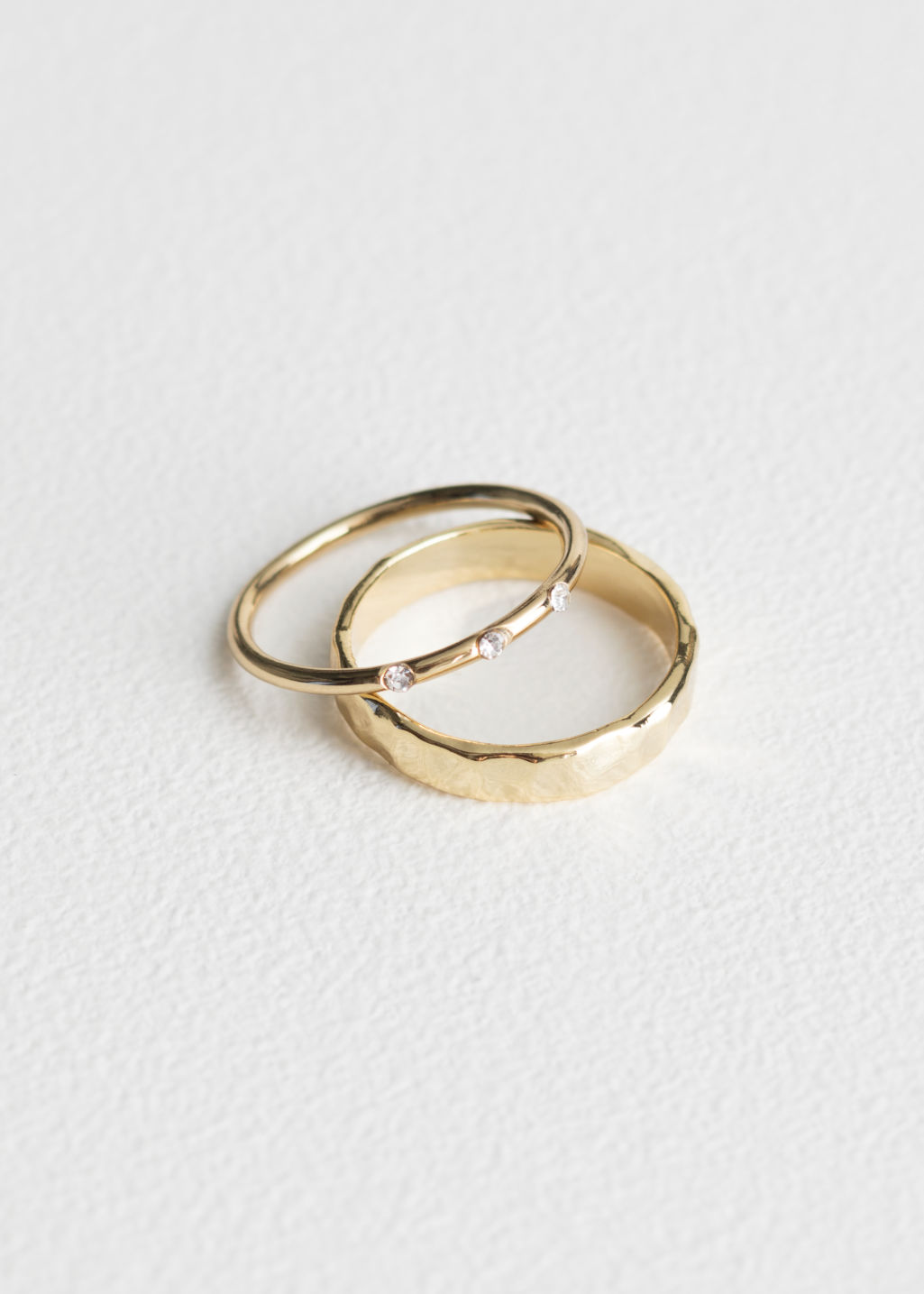 Front image of Stories 2 pack rings in gold