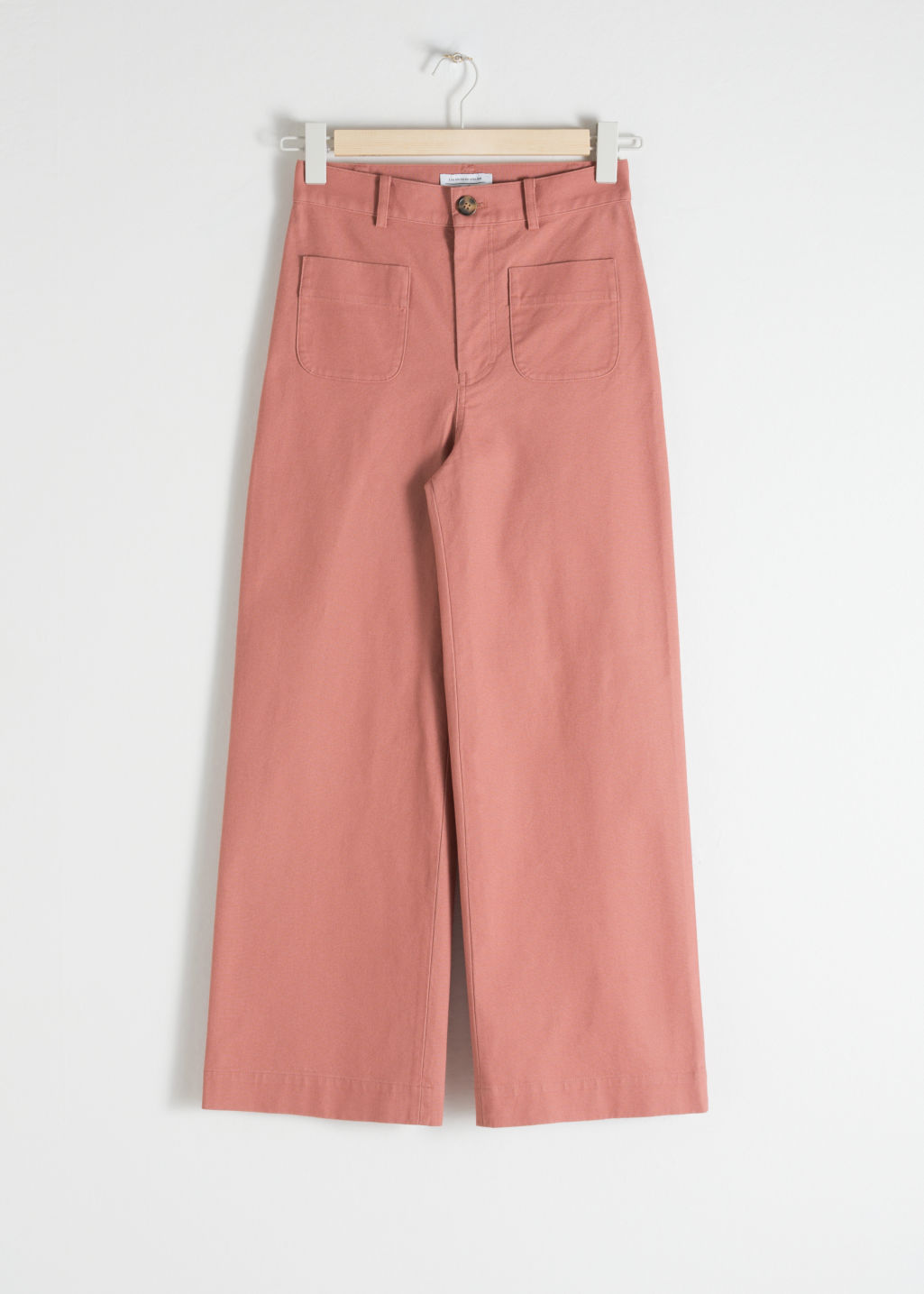 Front image of Stories high waisted twill trousers in orange
