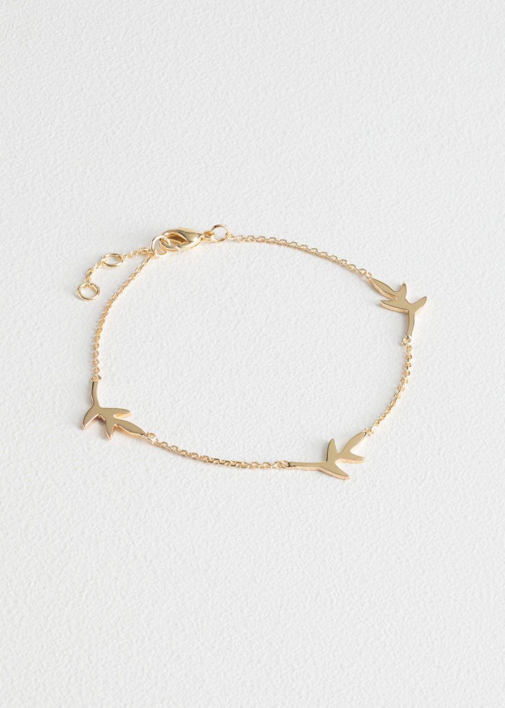 Front image of Stories olive branch chain bracelet  in gold