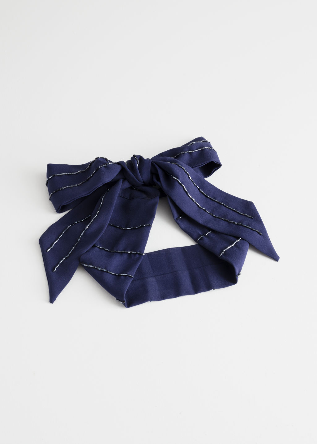 Front image of Stories long tie hairband in blue