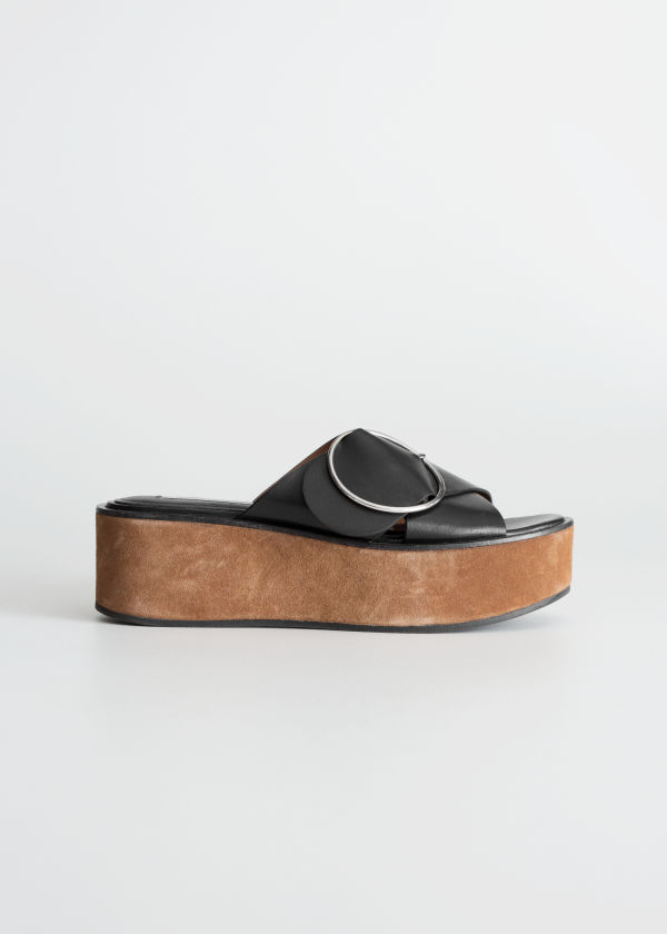 Front image of Stories circle buckle platforms in black