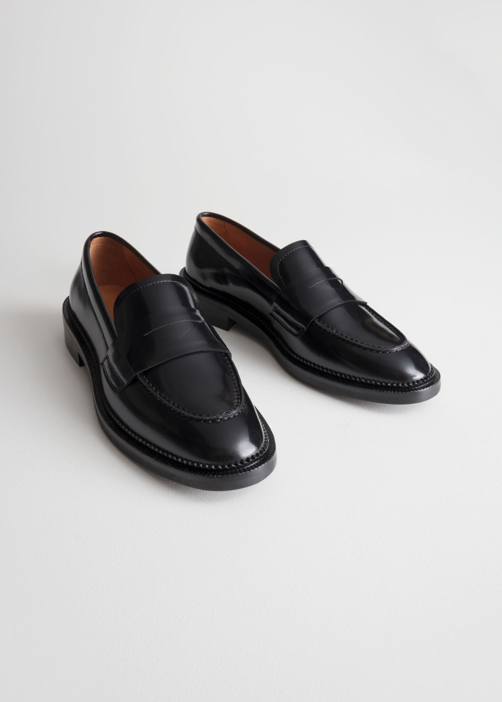 Front image of Stories round toe loafer in black