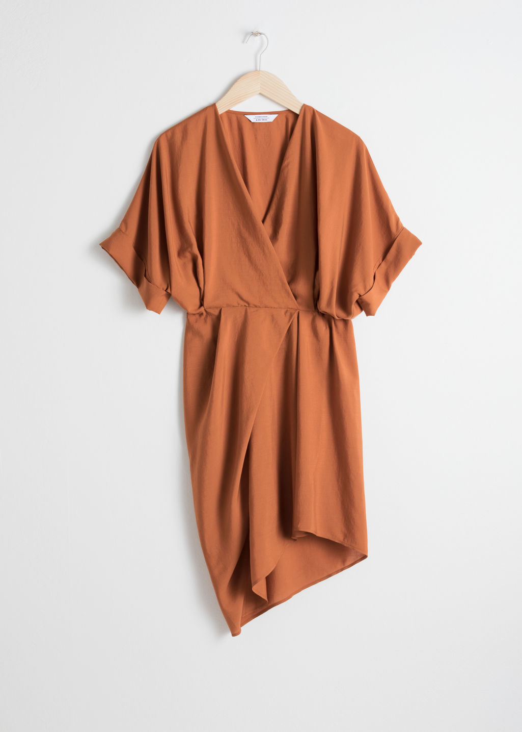 Front image of Stories asymmetrical gathered wrap dress in orange