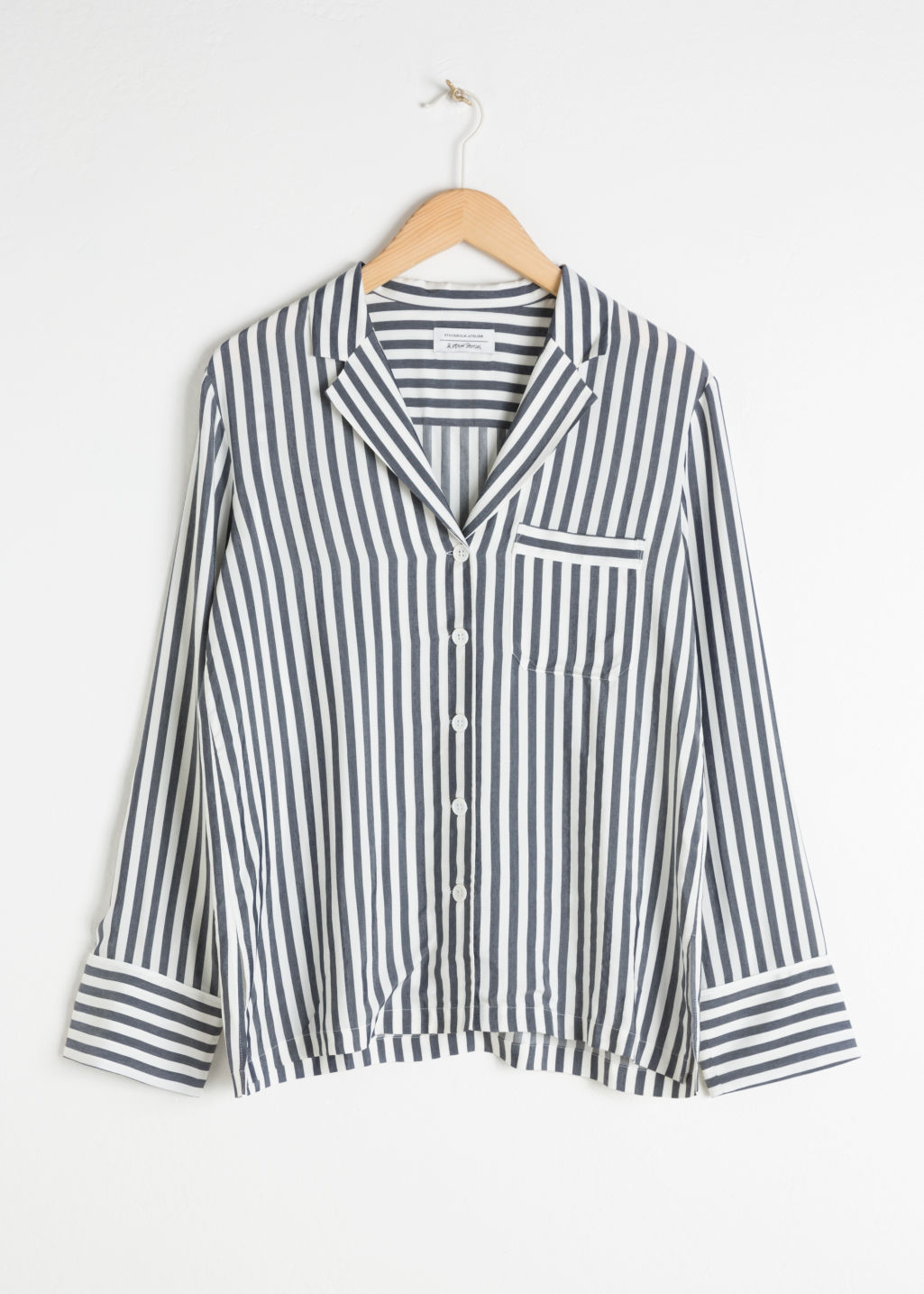 Front image of Stories striped lounge button down in blue