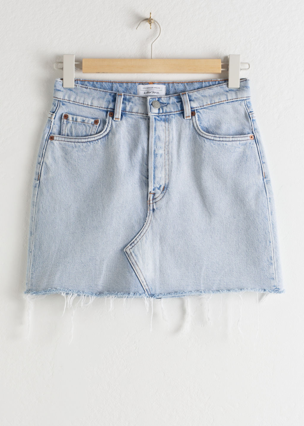Front image of Stories raw edge denim mini skirt in blue