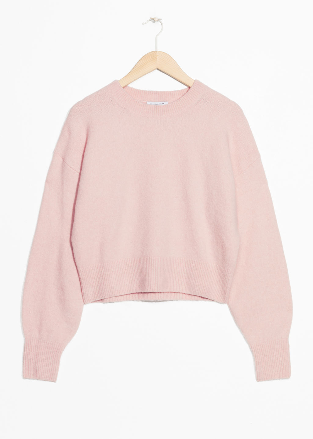 Front image of Stories crewneck sweater in pink