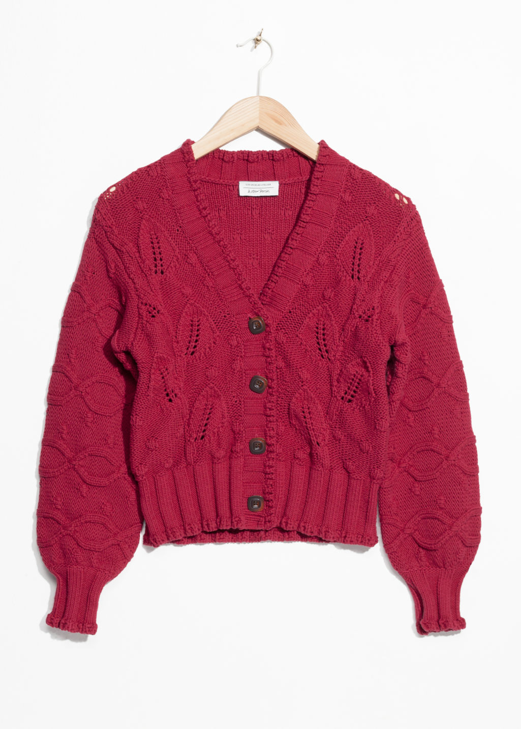 Front image of Stories chunky knit cardigan in red