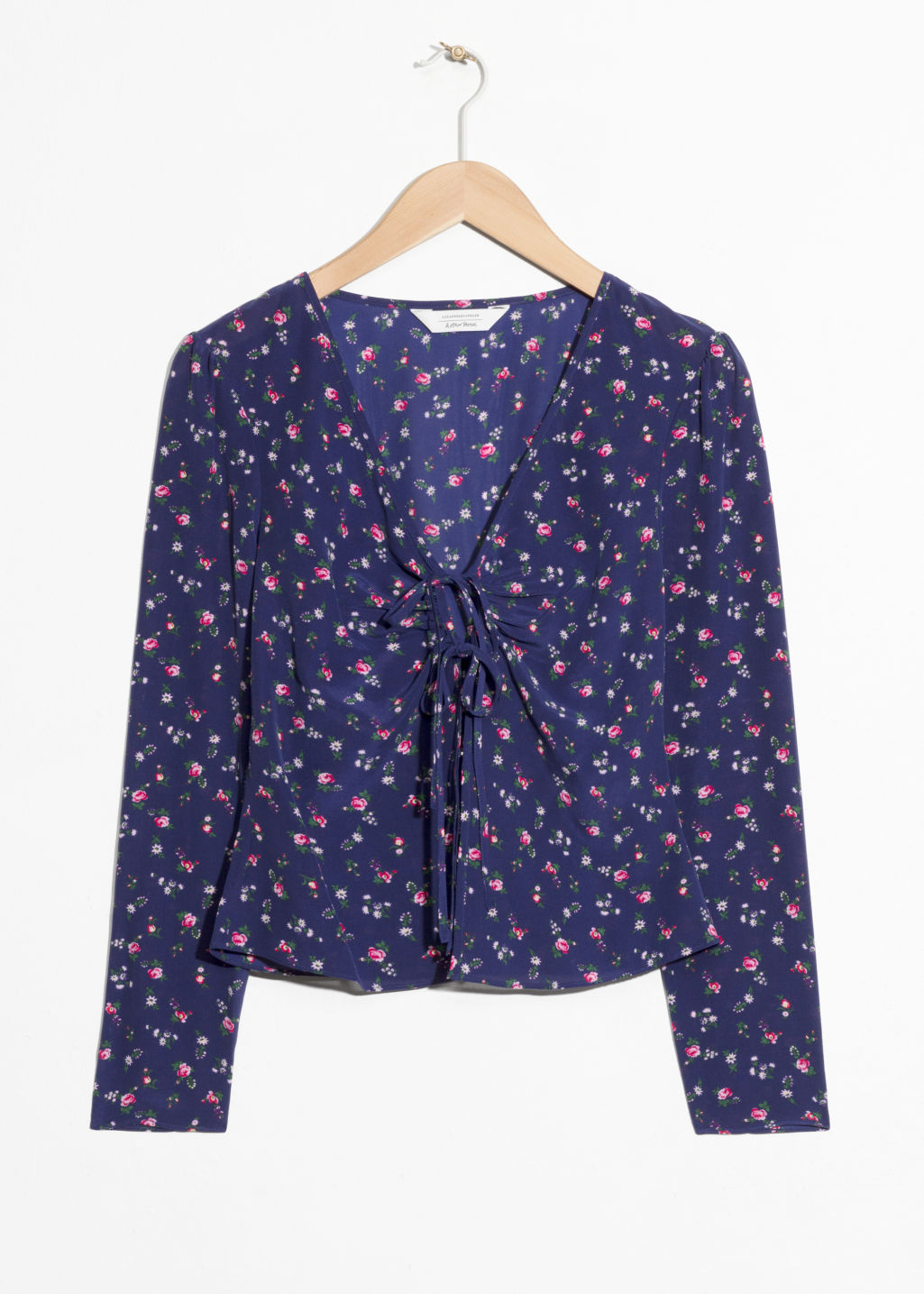 Front image of Stories printed tie up silk blouse  in blue