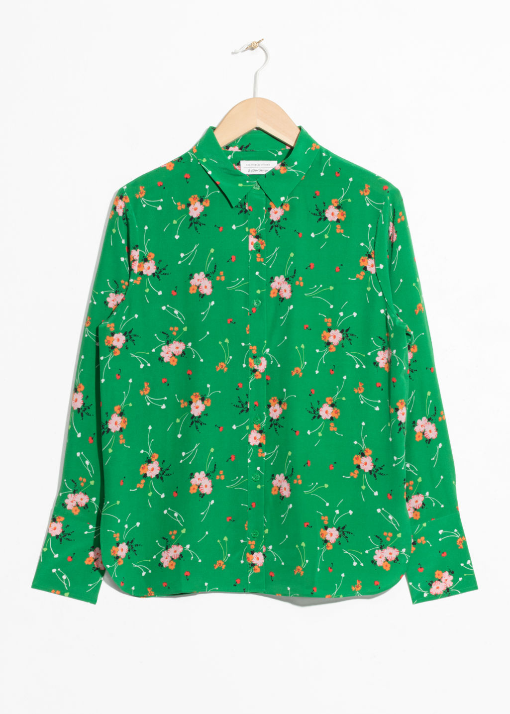 Front image of Stories silk button up blouse  in green