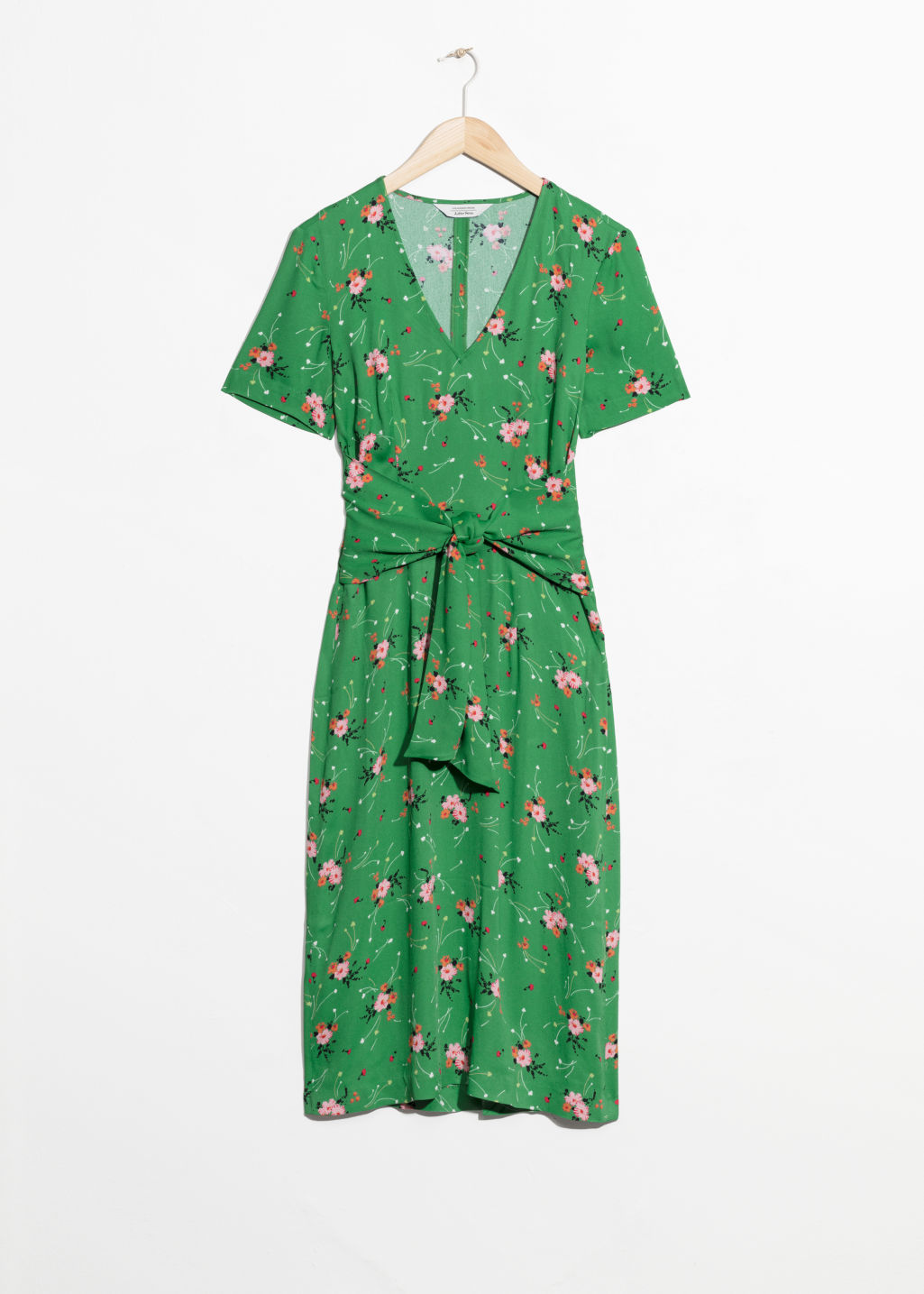 Front image of Stories printed waist tie dress in green