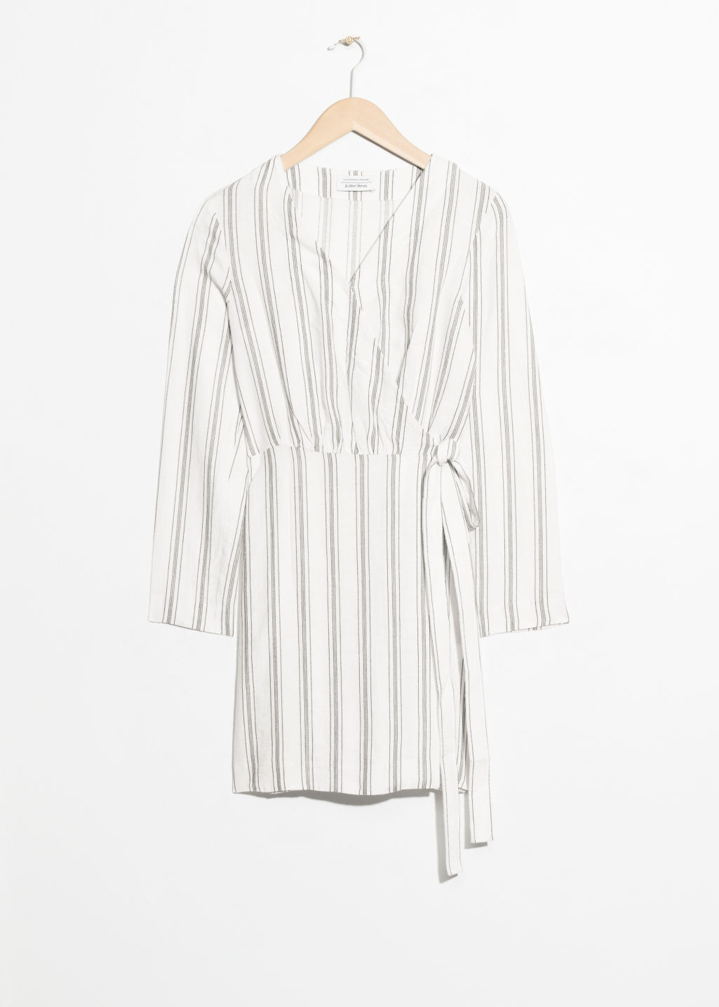 Front image of Stories striped wrap dress in white