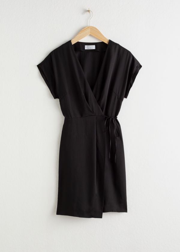 Front image of Stories sleeveless wrap dress in black