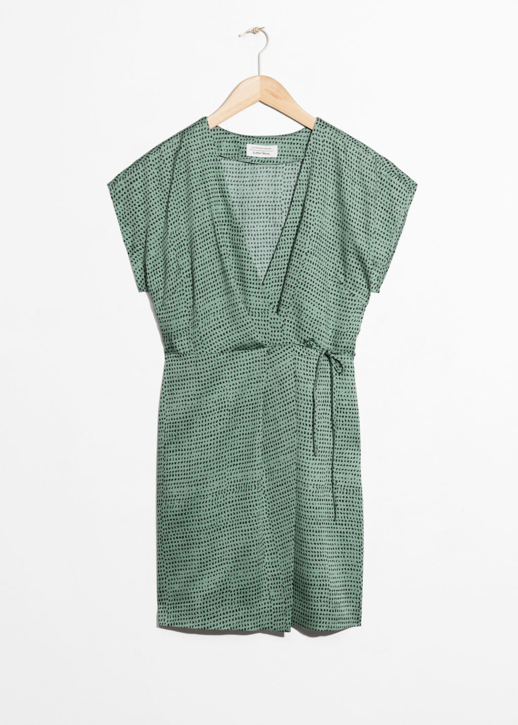 Front image of Stories sleeveless wrap dress in green