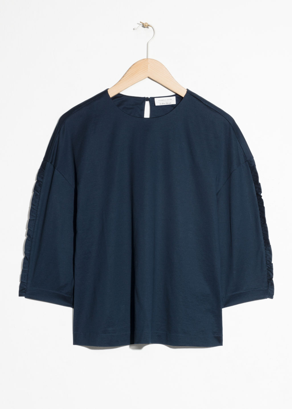 Front image of Stories ruffle sleeve top  in blue
