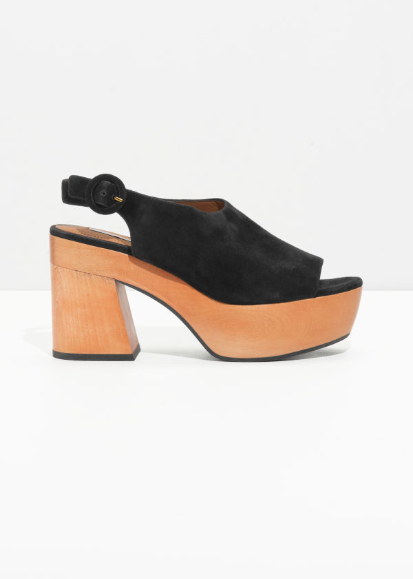 Front image of Stories suede platform clogs in black