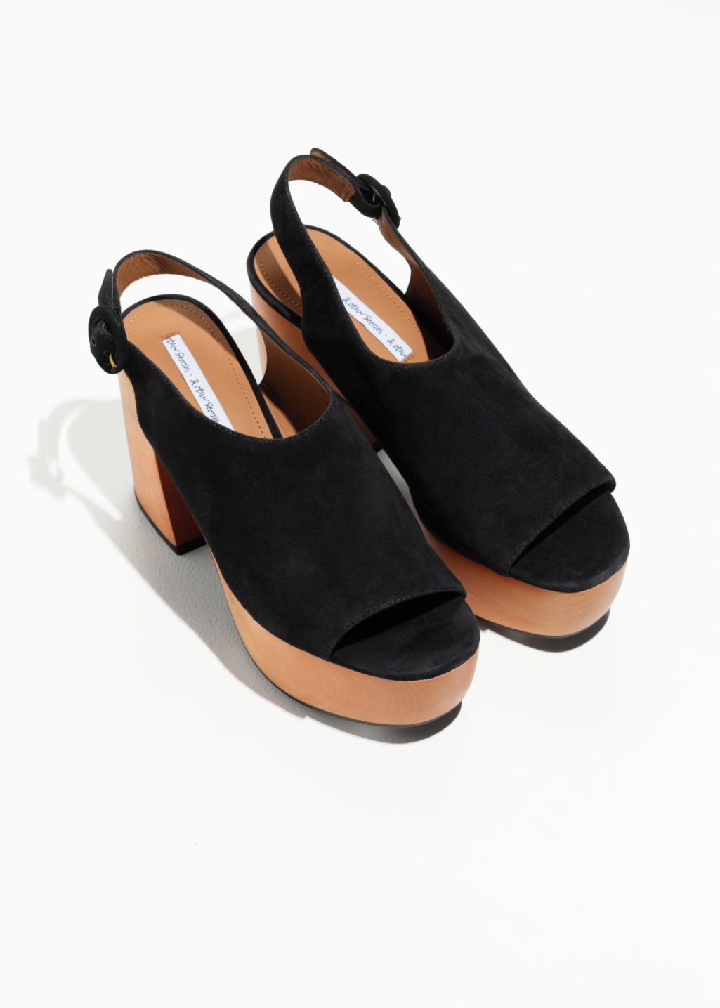 Back image of Stories suede platform clogs in black