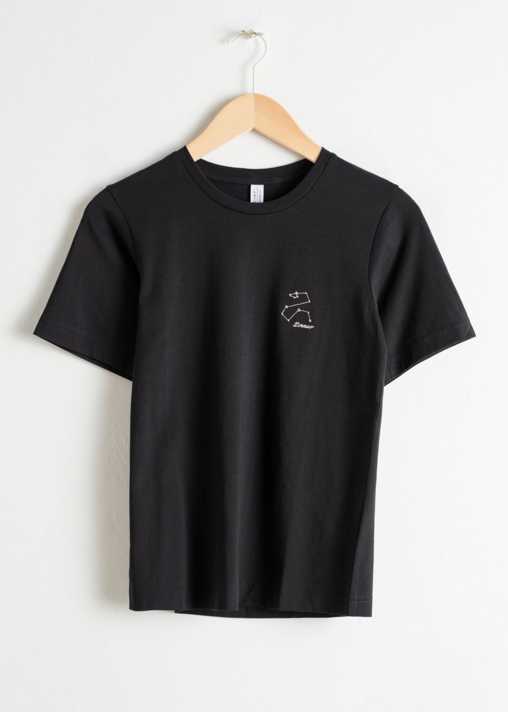 Front image of Stories heart other embroidered tee in black