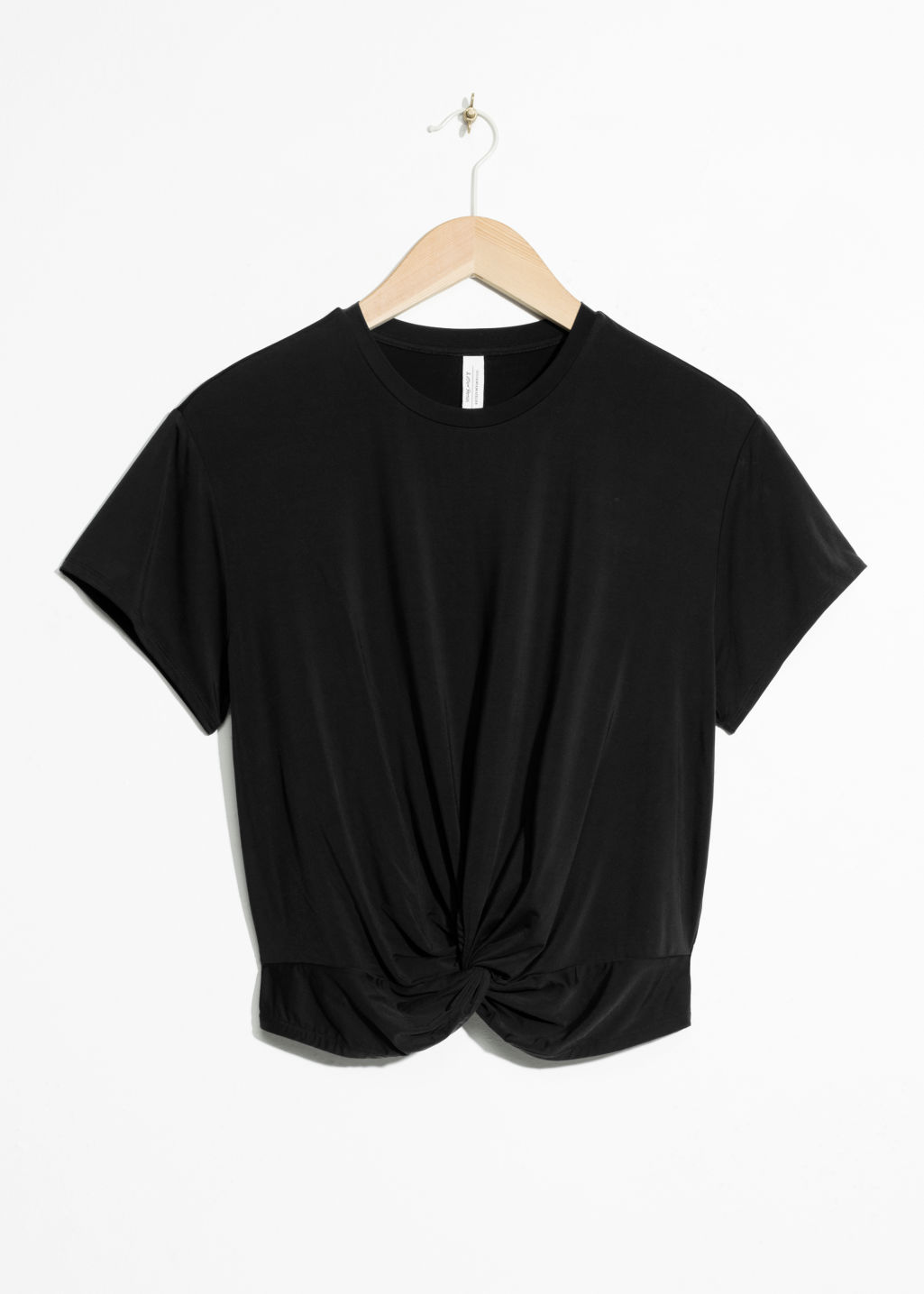 Front image of Stories twist knot top in black