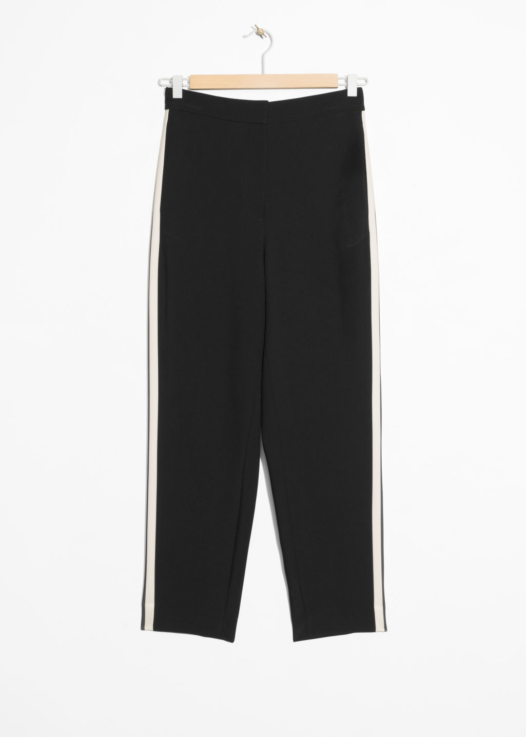 Front image of Stories tapered racer stripe trousers in black