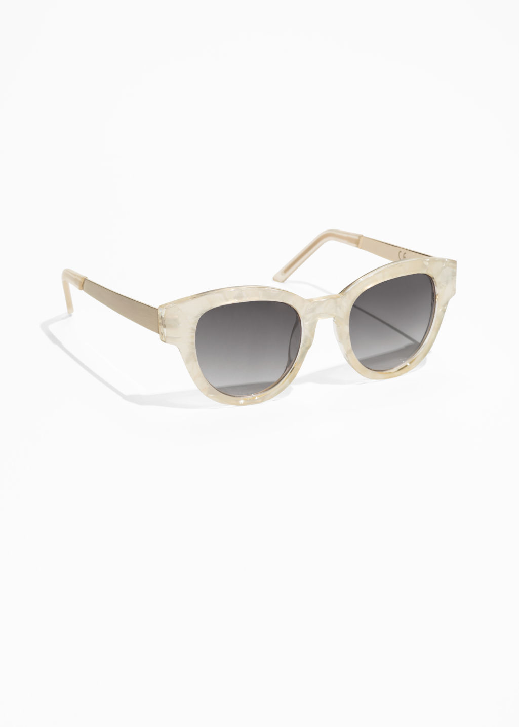 Front image of Stories pearl speckled sunglasses in white